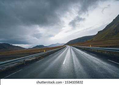 Mountain Iceland road in foggy, cloudy day. Backplate road.