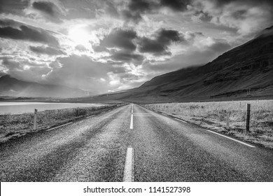Mountain Iceland road and picturesque natural landscape. Black-white photo.