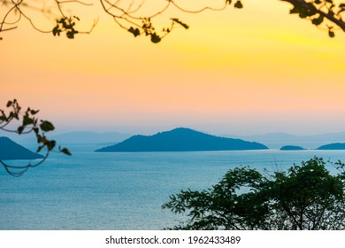Mountain island landscape on sunset sea with colorful sunset sky