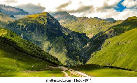 Mountain kazbek. Caucasus mountains. Beauty world. Cloudy morning view of the mountain hill in Upper Svanetia, Georgia, Europe.