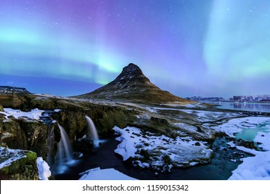 Mountain Kirkjufell and Aurora in Iceland.