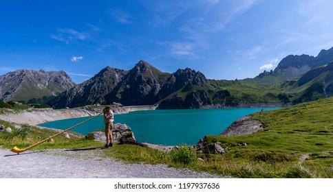 mountain lake with alphorn