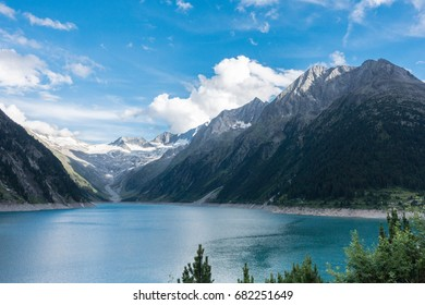Mountain lake in the Alps with glacier in the background