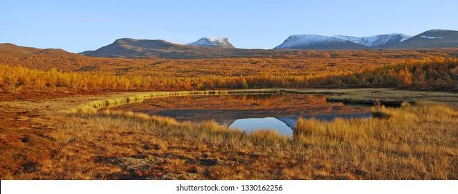 Mountain lake in autumn. Abisko national park in Sweden.