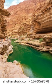 Mountain lake. The beautiful mountain scenery. Wadi Bani Khalid. Oman. Wadi Shab is a favorite outdoor place for hiking activities for tourists and locals.