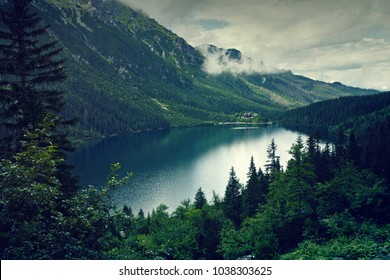 Mountain lake and clouds. Morskie oko in Tatry, Poland. Nature landscape.