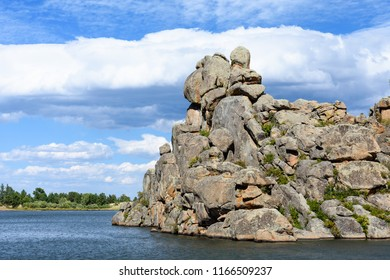 Mountain Lake in Colorado with dramatic clouds and rock formations