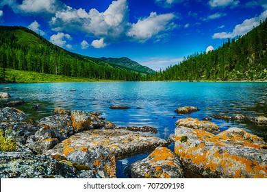 mountain lake in front of mountain range, national park in Altai republic, Siberia, Russia