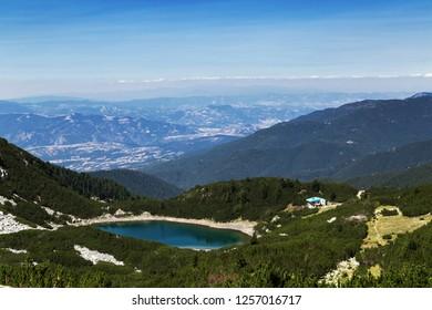 Mountain lake and hut in Pirin, Bulgaria