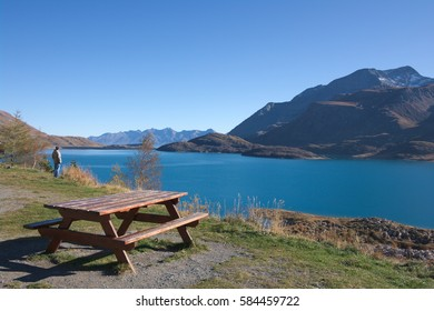 mountain lake landscape with bench, french Alps