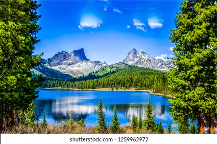 Mountain lake landscape. Mountain lake water view. Mountain lake panorama. Mountain lake reflection view