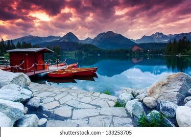 Mountain lake in National Park High Tatra. Dramatic overcrast sky. Strbske pleso, Slovakia, Europe. Beauty world.
