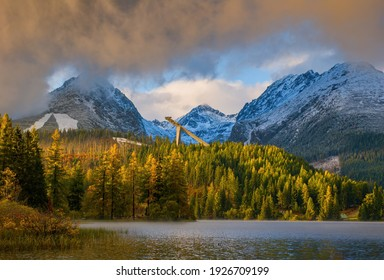 Mountain lake in National Park High Tatra. Strbske pleso, Slovakia, Europe. Ski jump stadium surrounded by trees and hills. Discover the beauty of earth.