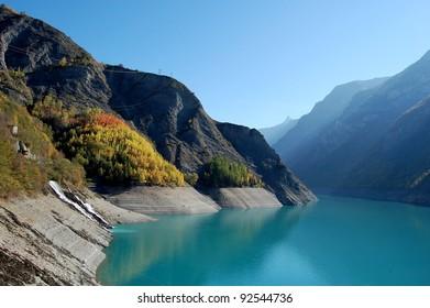 Mountain lake near Besançon, French Alps A beautiful autumn landscape near mountain city Besançon in France