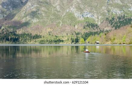 Mountain lake orange kayak crystal clear water