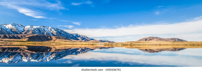 Mountain Lake Panorama Landscape Snow Capped Peaks Reflection On Water, Wide Scenic View Of Nature In New Zealand National Park, Tourism Travel Destination Near Christchurch Canterbury, South Island