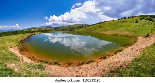 A mountain lake and pastures. Osogovski mountains , Macedonia.