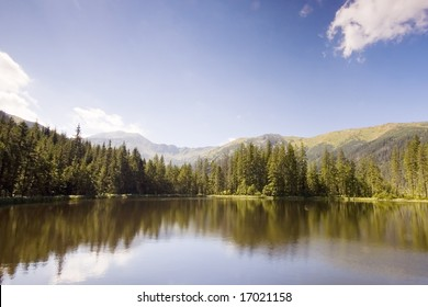 Mountain lake in Polish Tatras reflecting a forest