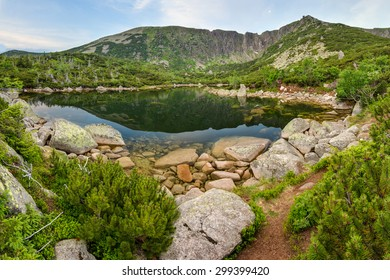 Mountain Lake / Quiet hidden glacier lake in Giant Mountains, Poland. Amazing atmosphere feeling totally free and alone in the wilderness.