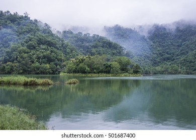 Mountain Lake in the rain and foggy day