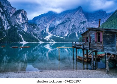 Mountain lake reflection with house