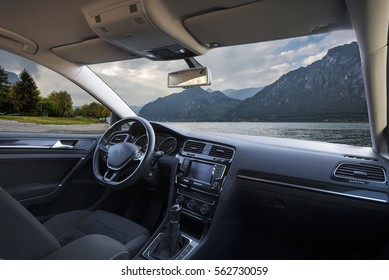 mountain lake seen from the inside of a car