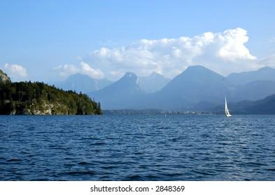 Mountain lake St Wolfgang in Salzkammergut, Austria, with sailboat