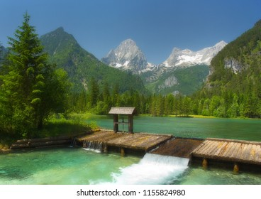 A mountain lake with water gate and peaks on background, Totes G