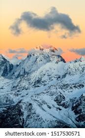 Mountain landscape in autumn or winter in Caucasus Mountains i Russia and Georgia. Mountain ridge over blue sunny sky, Russia