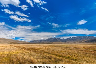 Mountain landscape with beautiful sky and clouds. Plateau Ukok, Altai