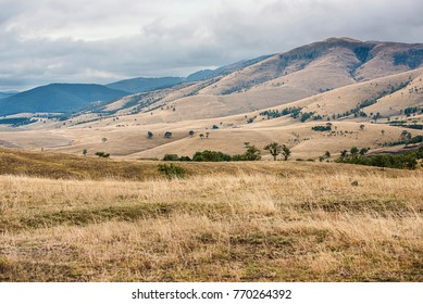 Mountain landscape with dry grass and clouds