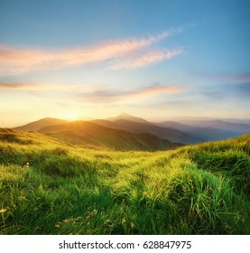 Mountain landscape during sunrise. Natural landscape in the summer time