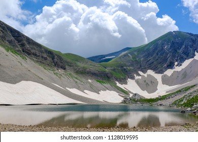 Mountain landscape with high altitude lake (Pilato lake)  in the National Park of the Sibillini Mountains in Italy