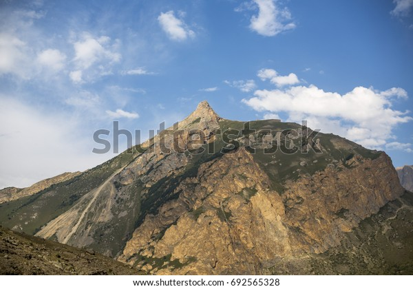 Mountain landscape. High rocks in the picturesque gorge, a beautiful view of the mountain district. Wild nature and mountains of the North Caucasus