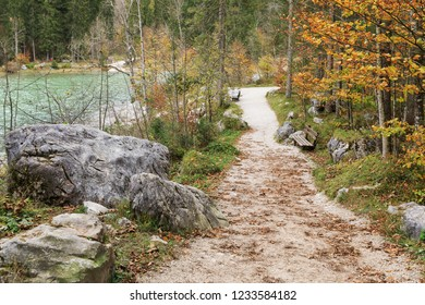 Mountain landscape with hiking trail through the Zauberwald (Magical Forest) at the mountain lake Hintersee in Bavaria, Germany with boulders from a rockslide. Ramsau bei Berchtesgaden.