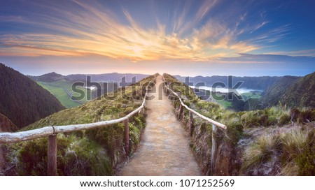 Mountain landscape with hiking trail and view of beautiful lakes Ponta Delgada, Sao Miguel Island, Azores, Portugal.