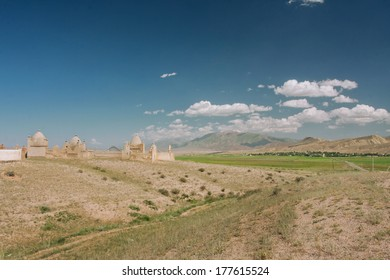 Mountain landscape with historical Muslim cemetery under the blue sky in the Middle East
