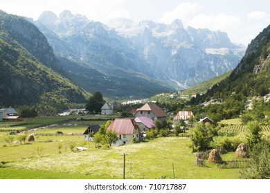 Mountain landscape with houses and farms in Theth in the Albanian alps