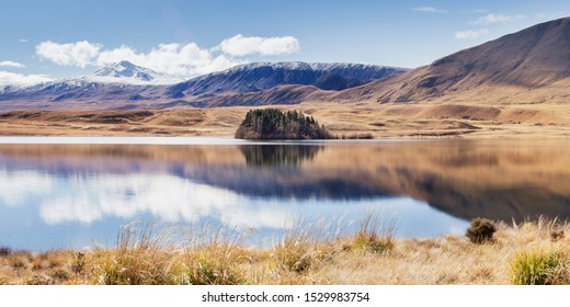 Mountain Landscape Lake In The Mountains, Beautiful Reflection Mountains On Water Surface, Panoramic View Of Scenic Landscape In Canterbury, South Island, New Zealand, Popular Travel Destination