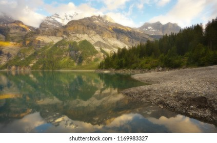 Mountain landscape with a lake of Oeschinensee during a sunset with a soft filter, Switzerland