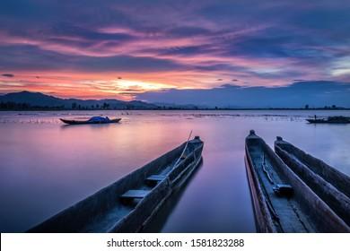 Mountain landscape, lake and mountain range, large lake and boat. Beautiful sunset reflected in the Lak lake, Buon Me Thuot, Vietnam - Shutterstock ID 1581823288