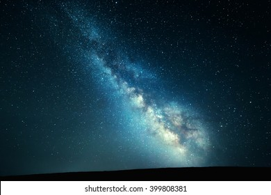 Mountain landscape with Milky Way. Beautiful night sky with stars at summer. Universe