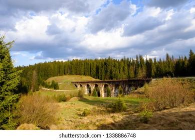 mountain landscape. with old viaduct bridge in Vorohta, Ukraine. Carpathian Mountains. Potter concept