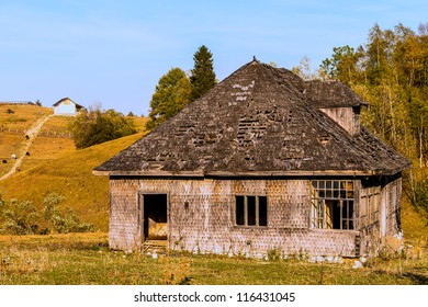 mountain landscape with old wooden house