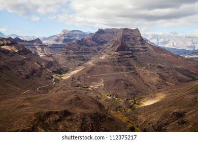 Mountain landscape on Gran Canaria island (Spain), between Maspalomas and San Bartolom���© de Tirajana (coordinates 27.81304,-15.582028)