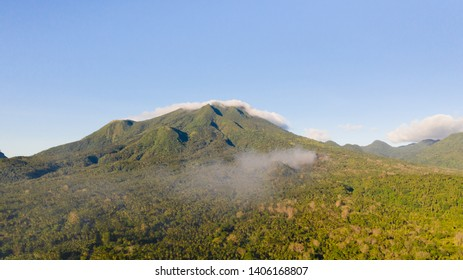 Mountain landscape on the island of Camiguin, Philippines. Volcanoes and forest. Hills and rainforest.