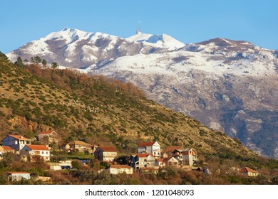 Mountain landscape on a sunny winter day. Montenegro, Dinaric Alps, view of snow-capped peaks of Lovcen mountain and Tivat town