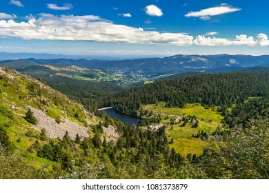 Mountain landscape: Overlooking view from the Gazon du Faing on the Forlet Lake in the Vosges Mountains in summer, Vosges, France.