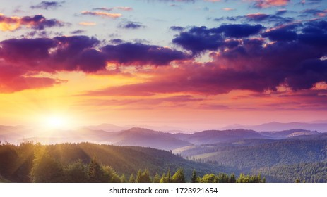 Mountain Landscape Panorama. Sunrise over the mountains. Mountain Landscape Panorama. Mountain landscape with colorful sunset on the sky