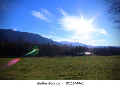 Mountain Landscape Photo with Rays of Sunlight in the Blue Skies.